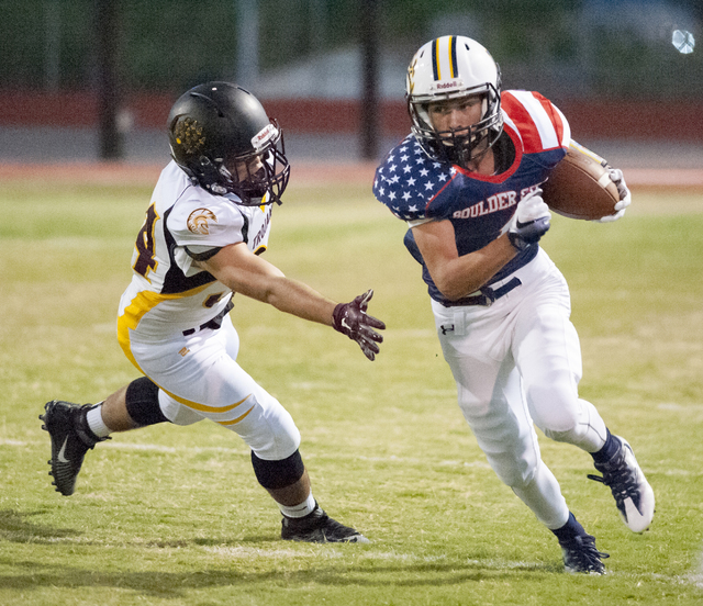 Boulder City High school ball carrier Briggs Huxford attempts to evade a would-be Pahrump tackler during first half action in the home game Friday. The Eagles lost 35-6. Steve Andrascik/Boulder Ci ...