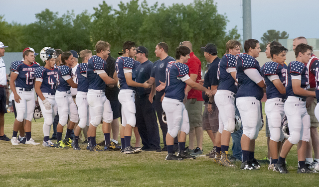 Members of the Boulder City High School football team shake hands with veterans and first responders before their game Friday. There was a special appreciation event honoring these patriots. Steve ...