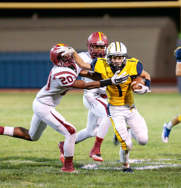 Donavon Lockett/Boulder City Review Boulder City High School Eagle Briggs Huxford, pushes away a defending Del Sol Dragon Christopher Williams, No. 20, during Friday's homecoming football matchup. ...