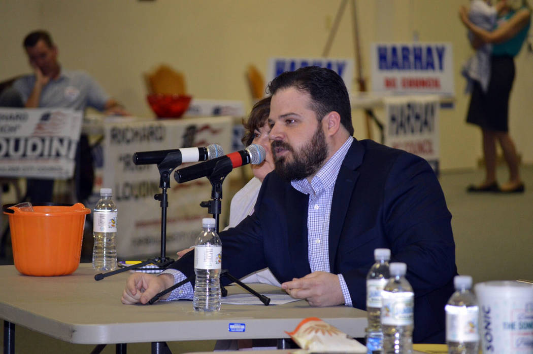 Celia Shortt Goodyear/Boulder City Review Nate Lasoff asks a question to the candidates at Tuesday's community forum held at the Elaine K. Smith Center. The event was co-sponsored by the Boulder C ...