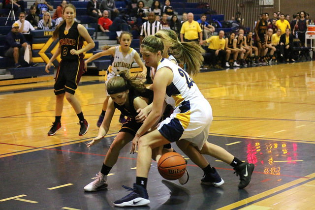 Laura Hubel/Boulder City Review Boulder City High School senior Julia Worrall, seen here fighting for the ball during the girls basketball team's Dec. 14 game against Pahrump Valley, said tough pr ...