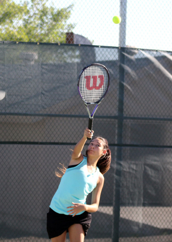 Robert Vendettoli/Boulder City Review Senior Kyra Yamamoto gets set to serve her doubles partner McKena Frazier during a practice session Tuesday at Boulder City High School.