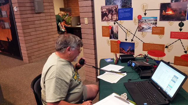 Bob Murray of Virginia Beach, Virginia, makes contact with a park ranger in Arizona on his ham radio while visiting Lake Mead National Recreation Area on Tuesday, July 5, 2016. Murray likes to go  ...