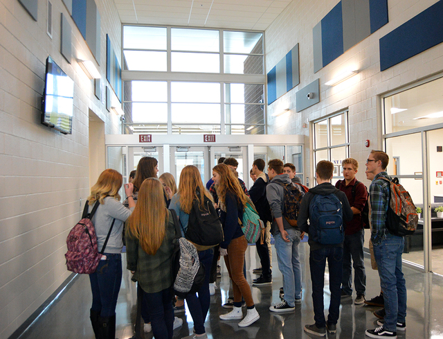 Max Lancaster/Boulder City Review  Boulder City High School students mingle and admire the new school building at the ribbon cutting ceremony on Tuesday. Seniors and teachers were more nostalgic f ...