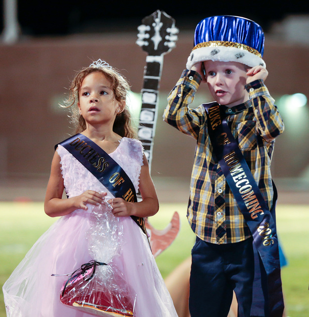 Donavon Lockett/Boulder City Review Homecoming court duchess Lana Attridge and duke Kolbe Boyle, kindergartners from Mitchell Elementary School, stand before the crowd after being announced at the ...
