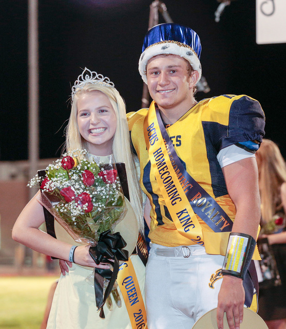 Donavon Lockett/Boulder City Review Newly crowned Boulder City High School homecoming queen Kelsey Bacon and king Michael Martinelli, pose for pictures during the halftime event during Friday's fo ...
