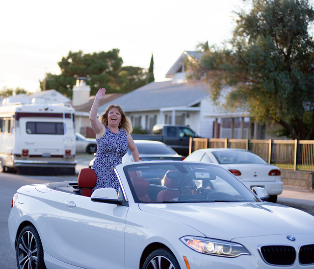 Noel Kanaley/Boulder City Review Boulder City High School Principal Amy Wagner waved to onlookers as they cheered on the homecoming parade Thursday, Sept. 29, 2016.