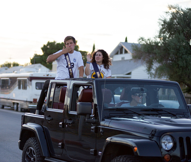 Noel Kanaley/Boulder City Review Members of Boulder City High School's senior Homecoming Court Ben Missel and Skylor McKay make their way slowly on Fifth Street toward California Avenue as family, ...