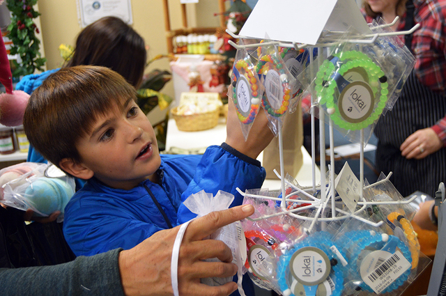 Max Lancaster/Boulder City Review  King Elementary student Ike Pappas, 10, looks at balance bracelets at the Boulder City Soap and Candle Co., 501 Nevada Way, on Dec. 8. Ike was spending money for ...