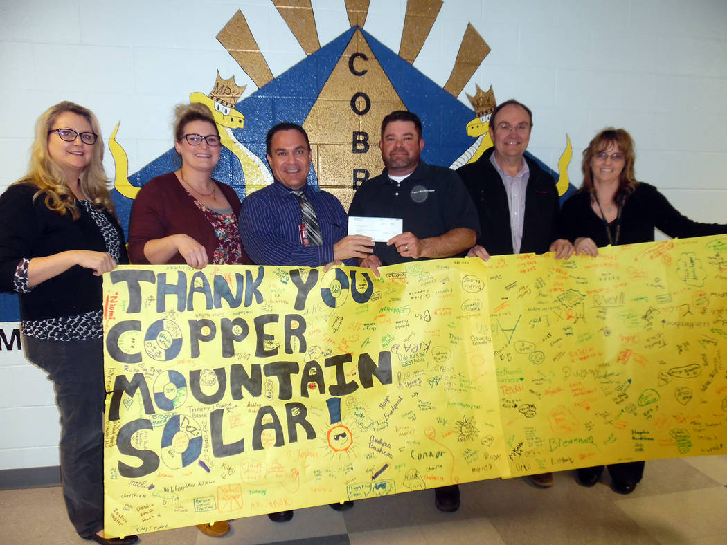 Hali Bernstein Saylor/Boulder City Review Students at King Elementary School signed a giant thank you card for Copper Mountain Solar, which donated $5,000 to purchase a math program that will help ...