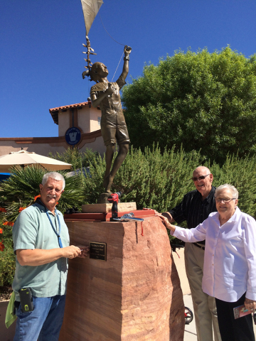 Hali Bernstein Saylor/Boulder City Review Richard Walker, left, helps Vern and Darlene Burk put the finishing touches on the final statue Boulder City Public Art Scape installed and donated to the ...