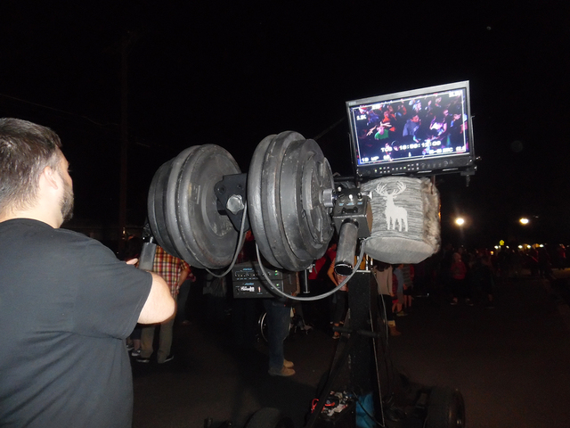 "Hali Bernstein Saylor/Boulder City Review A crew member from ABC's ""The Great Christmas Light Fight"" watches the monitor to see how filming is progressing at Dale Ryan and Dyanah Musgrave's Fifth  ..."