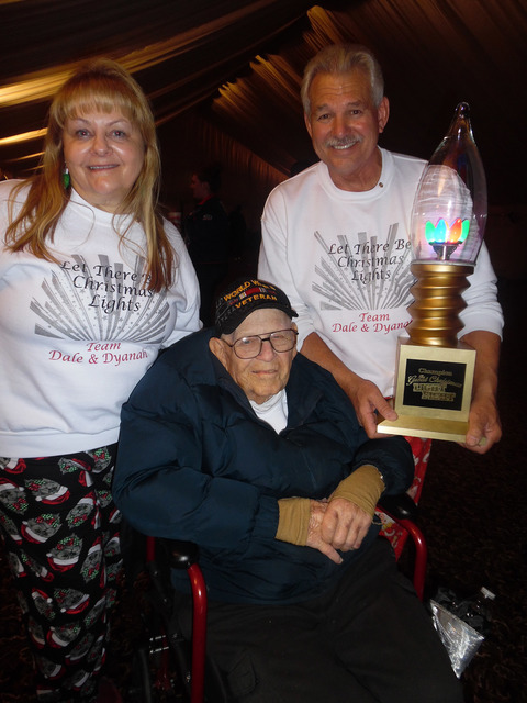"""Hali Bernstein Saylor/Boulder City Review Dyanah Musgrave, Bill """"Wild Bill"""" Ryan, center, and Dale Ryan show off the trophy they won after competing on ABC's """"The Great Christmas Light Fight."""" The ..."""