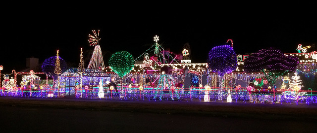 Hali Bernstein Saylor/Boulder City Review Dale Ryan and Dyanah Musgrave's home at 1525 Fifth St. has been attracting visitors for years to see their Christmas light display. This year, after compe ...