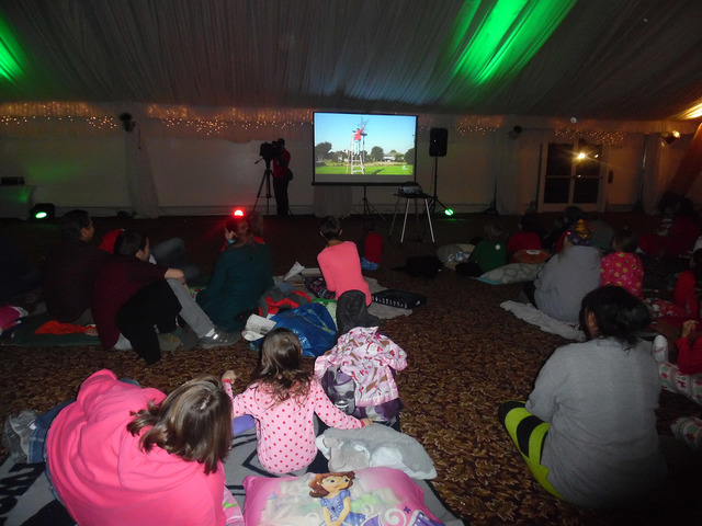 Hali Bernstein Saylor/Boulder City Review Families, wearing their best Christmas pajamas, gathered in the pavilion at Boulder Creek Golf Club to watch Boulder City residents Dale Ryan and Dyanah M ...