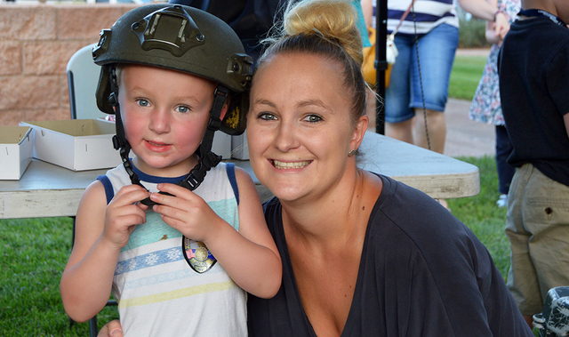 Ashley Rants and her son Easton, 3, play with Henderson Police Department's SWAT equipment. Easton didn't want to take off the tactical helmet. Max Lancaster/Boulder City Review