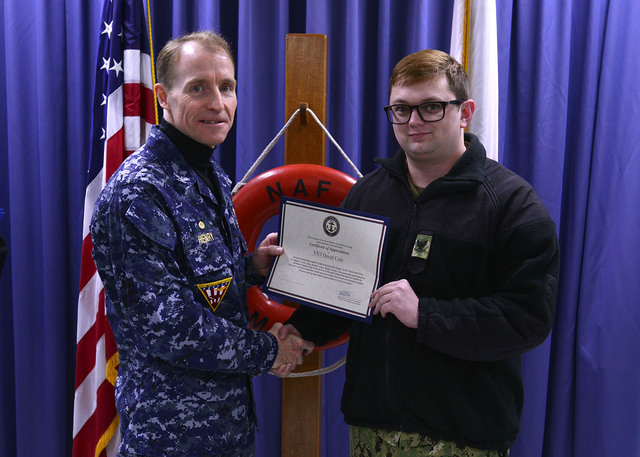 Courtesy photo  Petty Officer 3rd Class David Cole of Boulder City, right, receives a certificate of appreciation for his role in the success of the active-duty fund drive held for the Navy and Ma ...