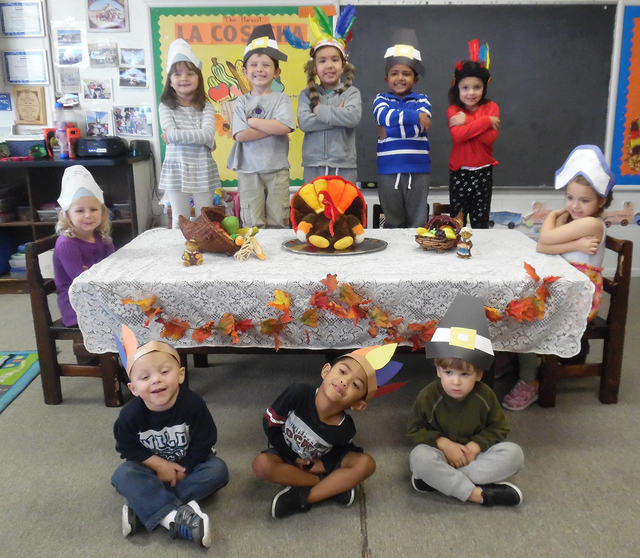 Hali Bernstein Saylor/Boulder City Review Oaklane Preschool Academy students, seated in front, from left, Tysen Martincheck, Riche Calombao, Aeden Kreegar, at table from left, Harper Dosch, Cariss ...