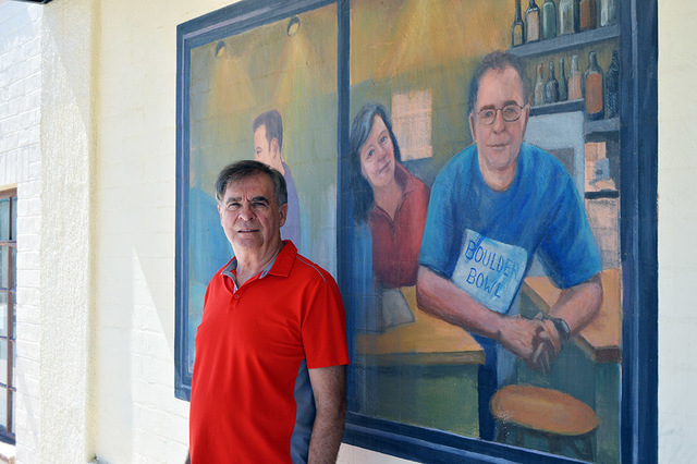 Max Lancaster/Boulder City Review Boulder City author Steve Osborne stands next of a mural of him painted in front of Boulder Bowl. Osborne is the former owner of the city's only bowling alley.  ...