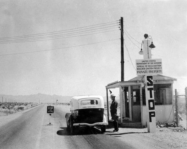 Courtesy photo A pass used to be required to enter Boulder City. An officer is shown checking entrance passes at a checkpoint near Railroad Pass in 1935.