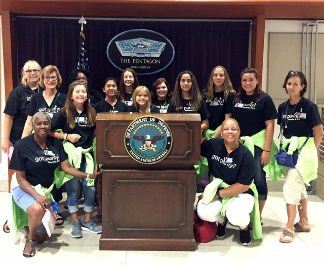 Members of Pride in Purity who went on the summer trip to Washington, D.C., and their chaperones gathered for a picture in The Pentagon. They are, kneeling in front, from left, Denise Ashurst, Yol ...