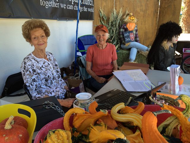 Hali Bernstein Saylor/Boulder City Review Nancy Seymore, left, and Kris Matuska, members of Boulder City United Methodist Church, were ready to help people pick their pumpkins at the church's pump ...