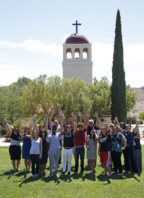 Children who live at St. Jude's Ranch for Children, along with ranch administrators and representatives from HomeAid of Southern Nevada, celebrate the donation and completion of a nearly $80,000 r ...