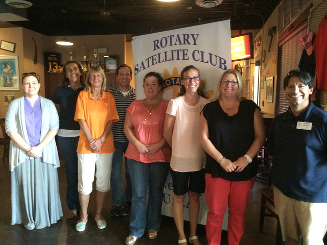 Hali Bernstein Saylor/Boulder City Review Larry Archuleta, right, congratulates recipients of minigrants presented by the Rotary Club of Boulder City on Sept. 13. Those receiving the awards includ ...