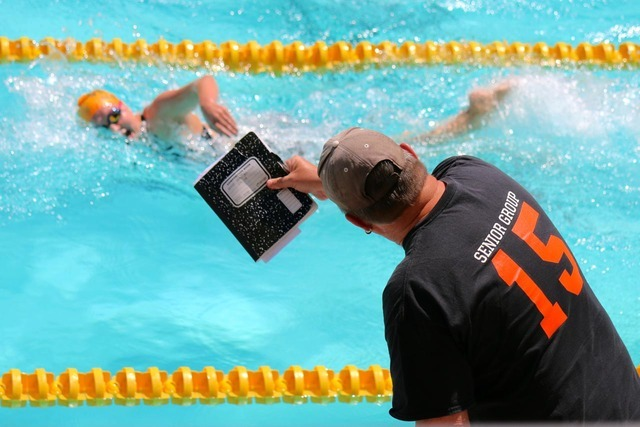 Desert Storm head coach Bill Carroll paces 17-year-old Abby Sauerbrei in the women's 800-meter freestyle during the Los Angeles Invite at the University of Southern California on July 14-15. Lau ...