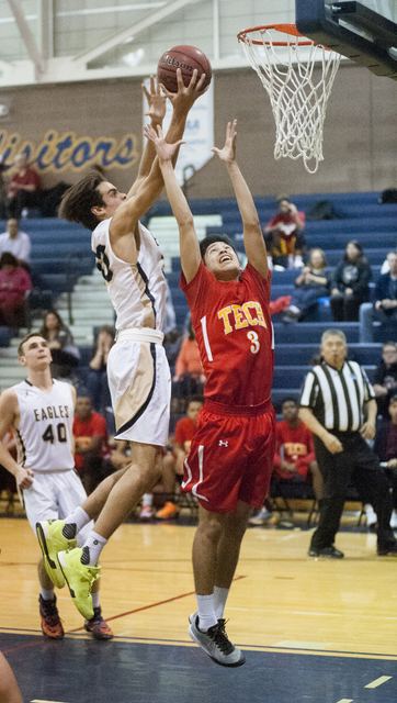 Steve Andrascik/Boulder City Review Boulder City High School basketball player Justus Green grabs a rebound in first-half action during the home game against Southeast Career Technical Academy on  ...