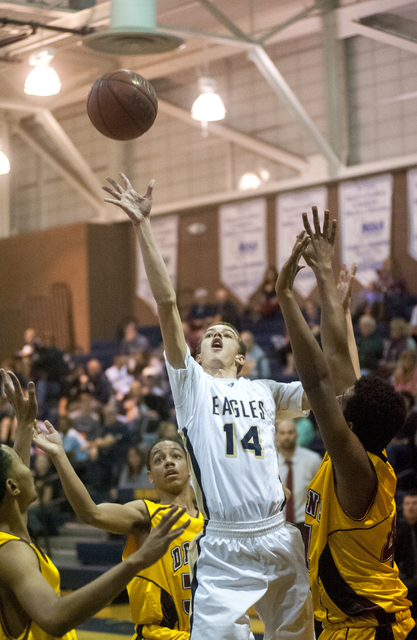 Steve Andrascik/Boulder City Review Boulder City High School sophomore guard Karson Bailey is surrounded by Del Sol defenders as he goes up for 2 points in the home game Feb 2. Bailey led his team ...