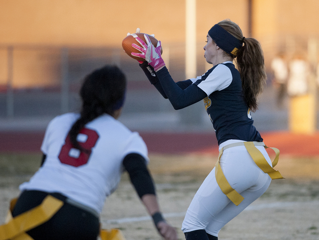 Steve Andrascik/Boulder City Review Boulder City High School receiver Kenadee Bailey pulls in a pass during the first half in the home game against Southeast Career Technical Academy on Tuesday. T ...