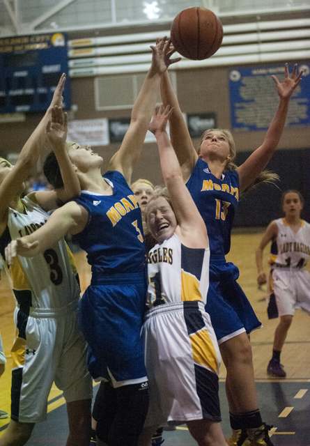 Steve Andrascik/Boulder City Review Boulder City High School senior Alea Lehr, at right, and sophomore Setia Cox, at left, try to grab a rebound against Moapa Valley in the home game Friday. The L ...