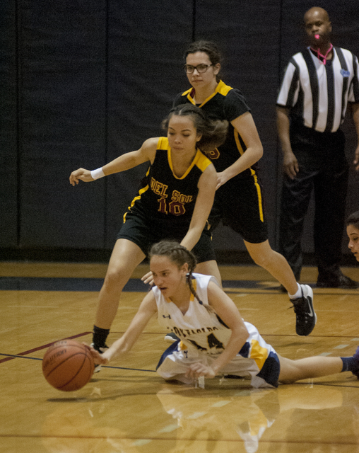 Steve Andrascik/Boulder City Review Boulder City High School freshman Keely Alexander attempts to gain possession of the ball in the home game against Del Sol on Feb. 2. The Lady Eagles crushed th ...