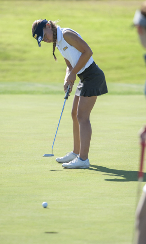 Steve Andrascik/Boulder City Review Boulder City High School golfer Lani Potter watches her putt on the first hole of the El Dorado course during the match against Green Valley High School at Boul ...