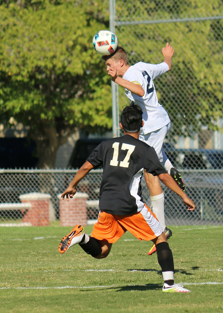 Laura Hubel/Boulder City Review Boulder City High School senior center back and captain Sebastian Balmer is miles above the Cowboys as he gets a jump and returns the kick back to center field duri ...