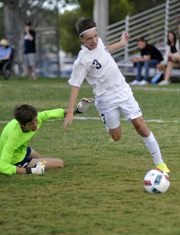 Boulder City High School soccer player Jackson Wright, No. 3, attempts to score a goal in the home game against Adelson School on Sept. 1. Boulder City lost 2-1. Steve Andrascik/Boulder City Review