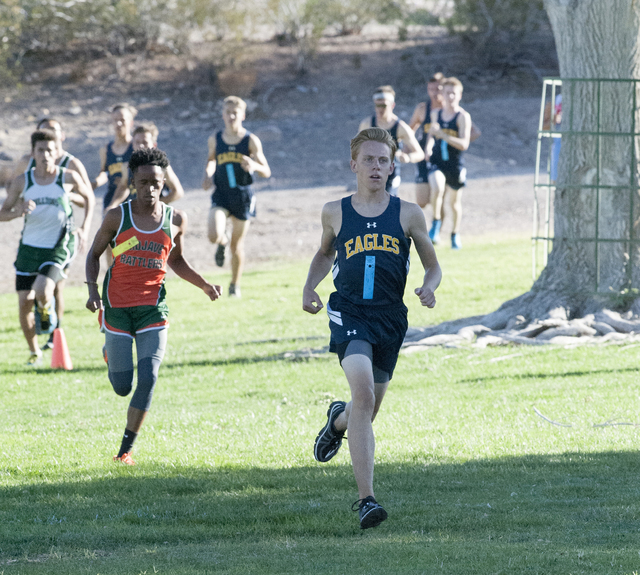 Steve Andrascik/Boulder City Review Boulder City High School cross-country runner Tyler Campbell takes an early lead in the 3.1 mile, 5K race in Hemenway Valley Park on Sept. 14. Campbell led the  ...