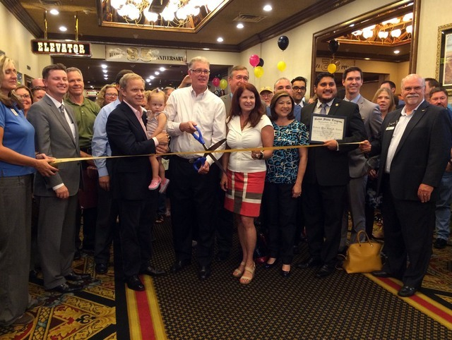Railroad Pass owner Joe DeSimone, third from left in black, joins with Henderson Mayor Andy Hafen, center, and other state, county and city officials to mark the 85th anniversary of the casino, wh ...