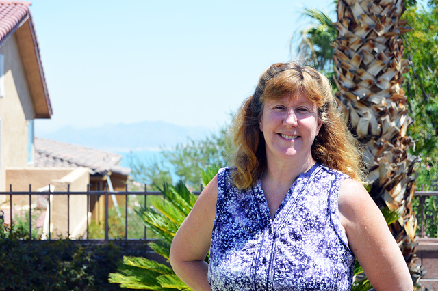"""Lisa Savy, seen in the backyard of her house in Boulder City, spends her time writing screenplays when she is not teaching math at the College of Southern Nevada. Her latest film, """"Dreams I Neve ..."""