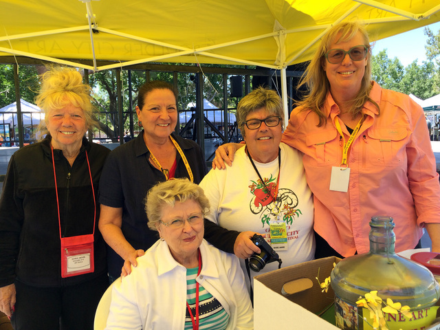 File photo Boulder City Art Guild members, standing, from left, Diana Meyer, Yolanda Grouell, Rose Ann Miele, Nancy Swart and Maribeth McLay, seated, volunteered their time and expertise to answer ...