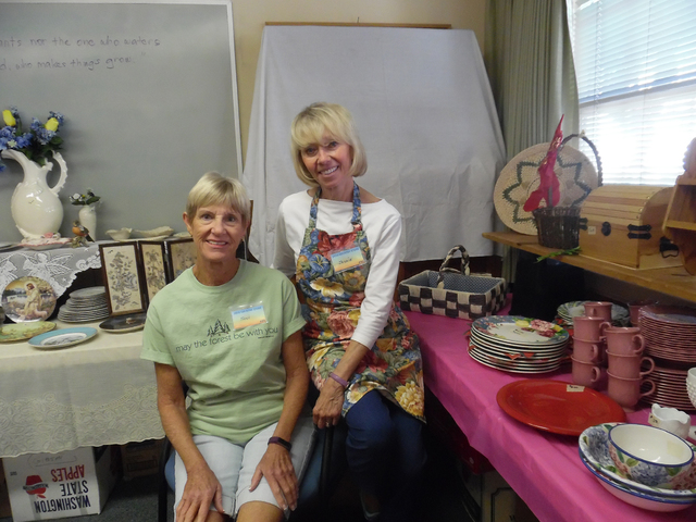 Hali Bernstein Saylor/Boulder City Review Toni Epler, left, and Jackie Neal work in the boutique area of Grace Community Church's annual Country Store on Friday. This is Epler's third year helping ...