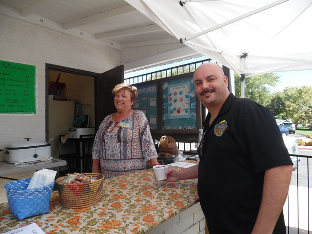 Hali Bernstein Saylor/Boulder City Review Marty Oakley serves a bowl of chili to Keith Dallura on Friday during the 69th annual Country Store presented by Grace Community Church. The chili is a st ...