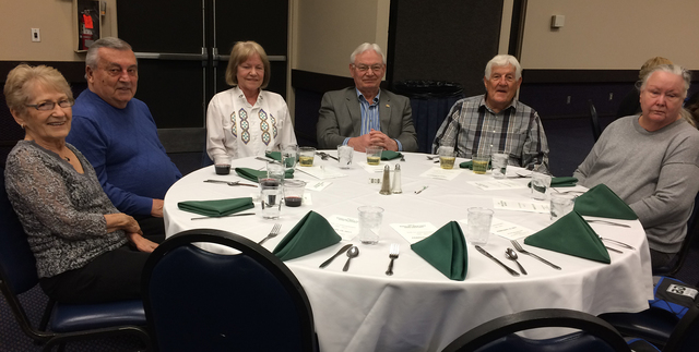 Hali Bernstein Saylor/Boulder City Review Waiting for dinner to be served before the start of Boulder Dam Credit Union's annual meeting Feb. 15 at the Henderson Convention Center were, from left,  ...