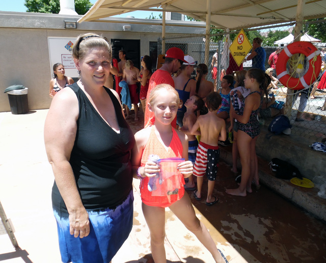 April, left, and Addison Roberts, 9, returned to Boulder City from Las Vegas to enjoy the coin toss and all the events at their fourth, and the 68th annual Damboree July Fourth celebration. Hunter ...