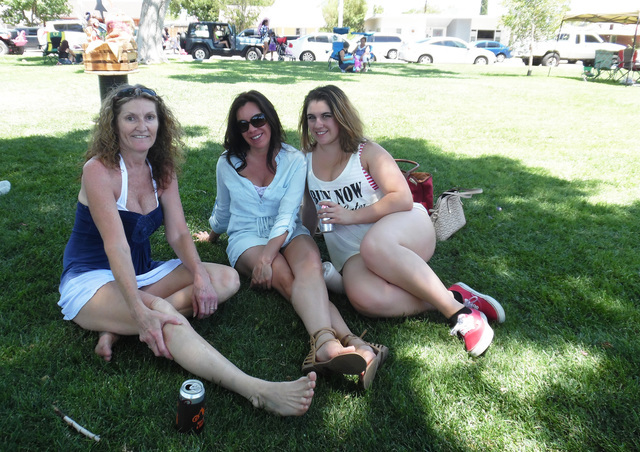 Darlene Krause, from left, Michelle Chrovian and Calli Brock enjoy the 68th annual Fourth of July Damboree festivities at Broadbent Park. Hunter Terry/Boulder City Review