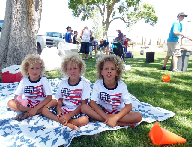 Axl, 6, from left, Sawyer, 6, and Vann Watkins, 7, enjoyed a break from the Las Vegas heat with an afternoon of fun and games at Broadbent Park during the 68th annual Fourth of July Damboree celeb ...