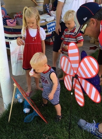 Twenty-two month old Emmett Losee plays one of the games in Broadbent Park's Kids Zone during the Damboree celebration on Monday, July 4, 2016. His big sister, Lainey Losee, 7, looks on. Hali Bern ...