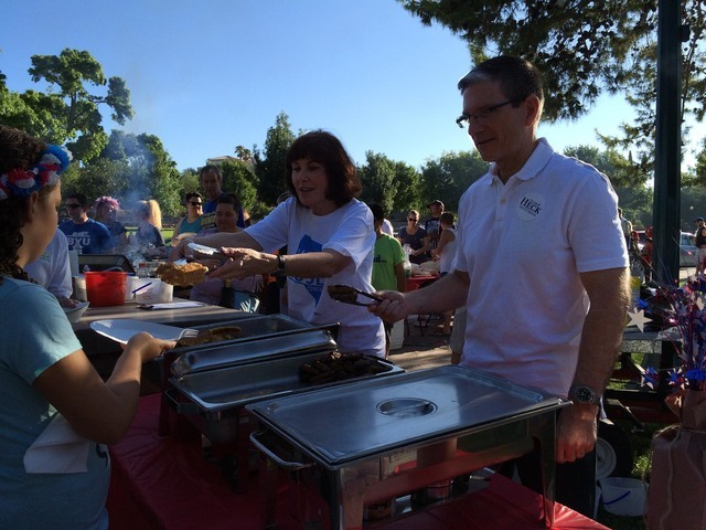 Jacky Rosen, a candidate for the 3rd Congressional District seat, and Rep. Joe Heck, a candidate for U.S. Senate, help serve breakfast in Bicentennial Park at the start of the 68th annual Damboree ...