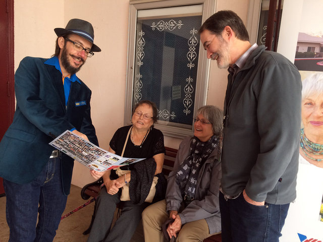 Hali Bernstein Saylor/Boulder City Review Lee Lanier, left, co-founder of the Dam Short Film Festival, goes over the schedule of events on Friday with visiting relatives and festival fans, from le ...